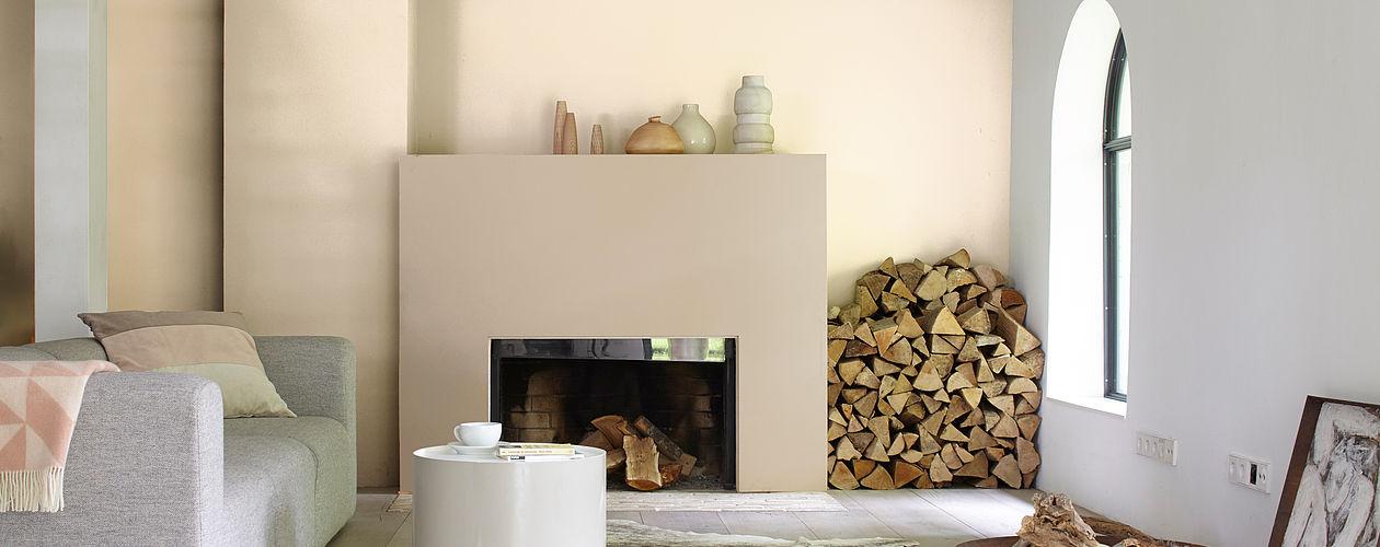 Mit Cremetönen und natürlichen Materialien wie Holz und Fell, schaffen Sie eine warme, gemütliche Atmosphäre.